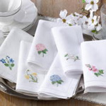 NM138 embr'd hollyhock hemstitch napkin