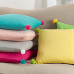 1671 solid pom pom pillow